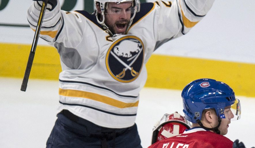 Buffalo Sabres' Nikita Zadorov celebrates his goal against Montreal Canadiens goalie Carey Price during the first period of an NHL hockey game Tuesday, Feb. 3, 2015, in Montreal. (AP Photo/The Canadian Press, Paul Chasson)