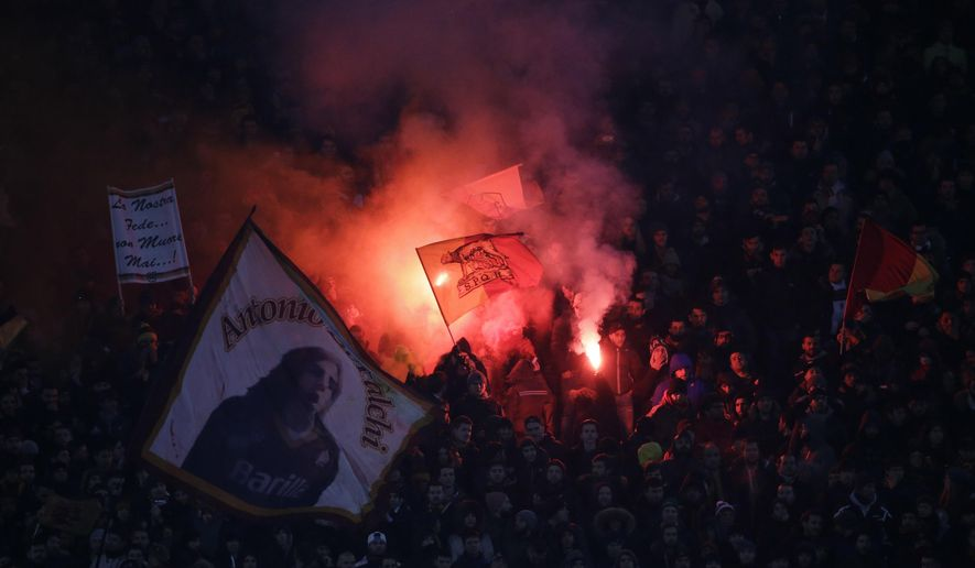 Roma supporters burn flares on the stands during an Italian Cup, quarterfinal match between Roma and Fiorentina, at Rome's Olympic Stadium, Tuesday, Feb. 3, 2015. (AP Photo/Andrew Medichini)