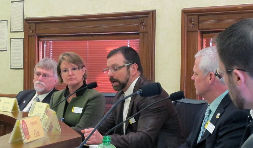 Wyoming State Rep. Eric Barlow, R-Gillette, third from left, comments on a bill that would have required physicians to inform women seeking abortions that they have the right to see an ultrasound image of a fetus and listen to its heartbeat before the procedure in Cheyenne, Wyo. on Tuesday, Feb. 3, 2015. The House Travel, Recreation, Wildlife and Cultural Resources Committee voted 6-to-3 against the bill. (AP Photo/Ben Neary)