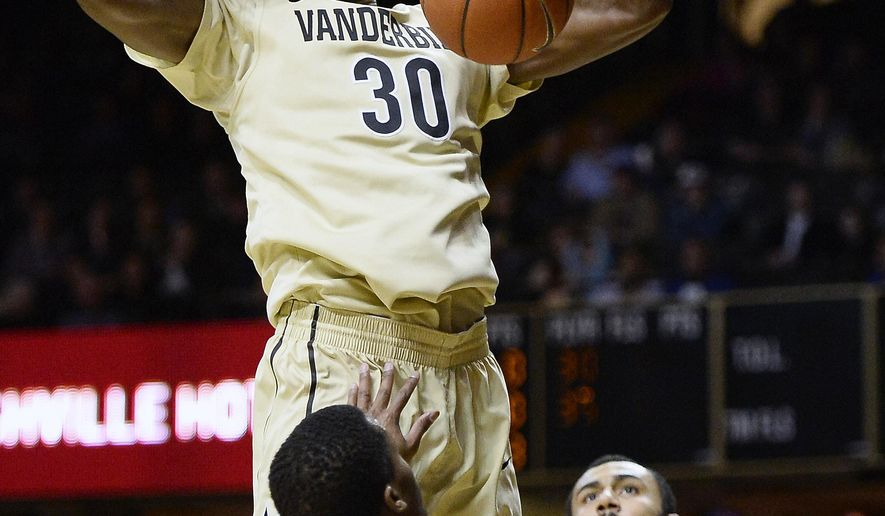 Vanderbilt center Damian Jones (30) dunks the ball over Florida guard Kasey Hill (0) and forward Jon Horford (21) in the first half of an NCAA college basketball game Tuesday, Feb. 3, 2014, in Nashville, Tenn. (AP Photo/Mark Zaleski)