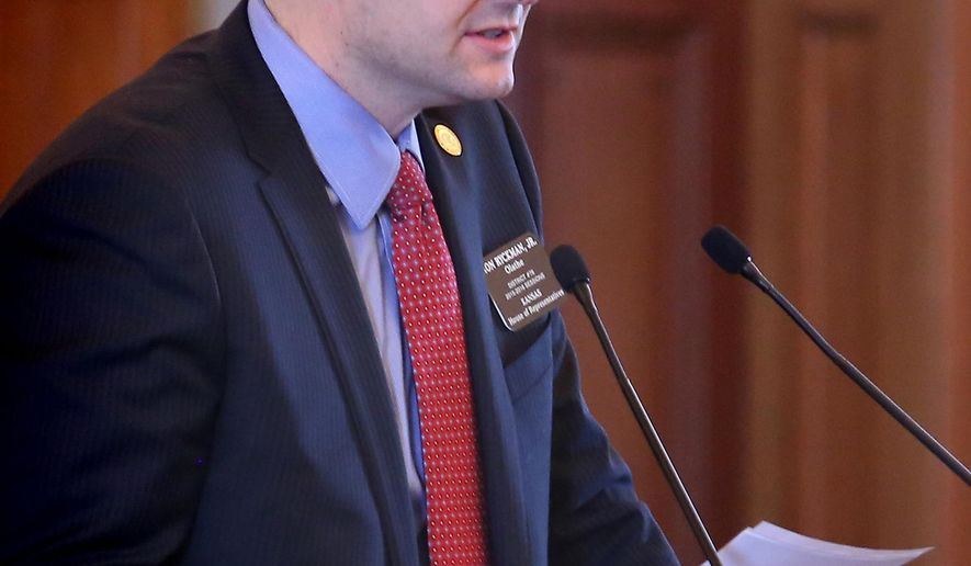 The House gave first-round approval, Tuesday, Feb. 3, 2015, to legislation that was carried on the floor by House Appropriations Chairman Rep. Ron Ryckman, Jr., R-Olathe. The bill is aimed at plugging a $330 million budget deficit this year. (AP Photo/Topeka Capital-Journal, Thad Allton)