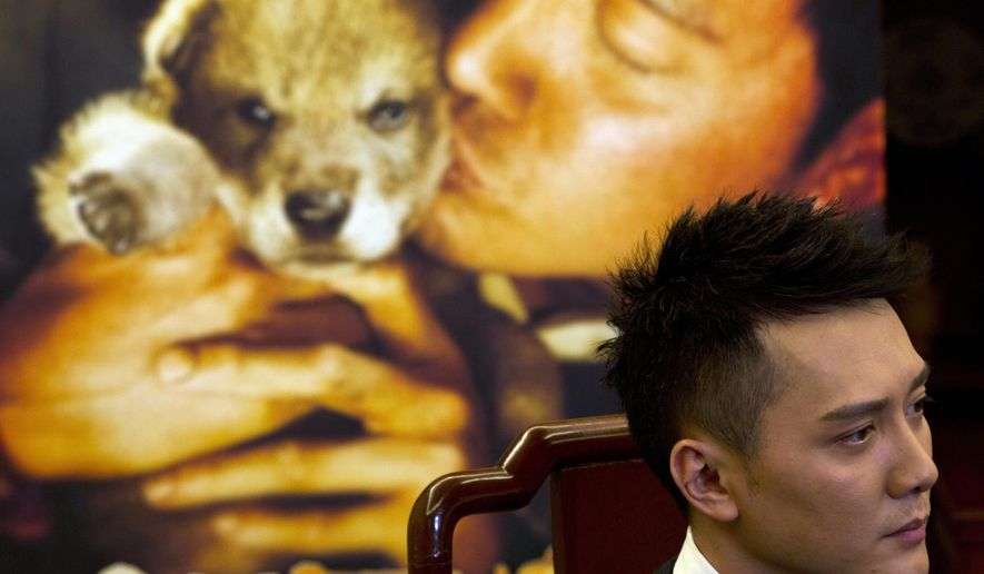 "Chinese actor Feng Shaofeng talks about his latest movie ""Wolf Totem"" which is based on a popular book by the same name during an interview in Beijing Tuesday, Feb. 3, 2015. Both French director Jean-Jacques Annaud and main actor, Feng, said the China-France co-production centered on the relationship between humans and nature, and taking care of the environment. ""The film is not just a film about China. It's for the whole world, and its theme is an issue everyone cares about,"" said Feng. (AP Photo/Ng Han Guan)"