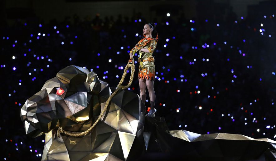 FILE - In a Sunday, Feb. 1, 2015 file photo, Katy Perry performs on a 30-foot-long, 14-foot-tall lion during halftime of NFL Super Bowl XLIX football game in Glendale, Ariz. The lion was made at Michael Curry Design, world-renowned theatrical production company based in Scappoose, Ore. (AP Photo/Mark Humphrey, File)