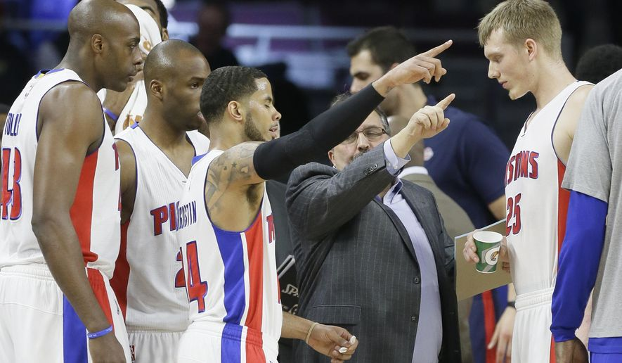 Detroit Pistons head coach Stan Van Gundy talks to Detroit Pistons guard D.J. Augustin (14) and others during the first half of an NBA basketball game against the Miami Heat, Tuesday, Feb. 3, 2015 in Auburn Hills, Mich. (AP Photo/Carlos Osorio)