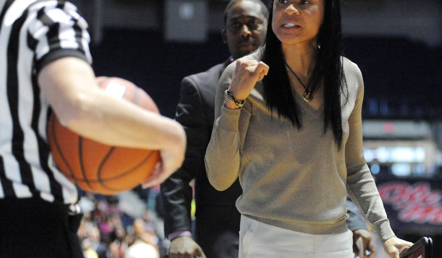 South Carolina coach Dawn Staley talks to an official during an NCAA college basketball game against Mississippi, Sunday, Feb. 1, 2015, in Oxford, Miss. (AP Photo/Oxford Eagle, Bruce Newman)