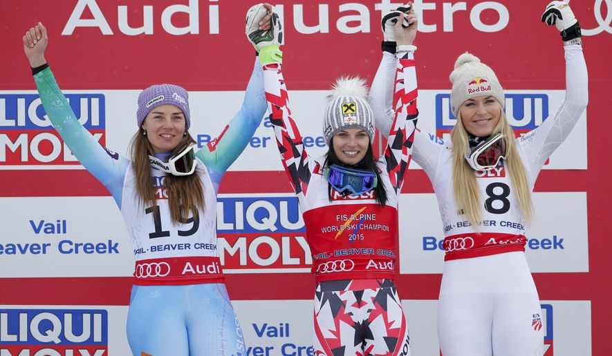 From left; Slovenia's Tina Maze, second place' Austria's Anna Fenninger, first place, and United States' Lindsey Vonn, third place, celebrate on the podium after the women's super-G competition at the alpine skiing world championships on Tuesday, Feb. 3, 2015, in Beaver Creek, Colo. (AP Photo/Marco Trovati)