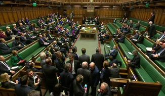 In this screen shot from Parliament, the debating chamber at the House of Commons after Members of Parliament is shown in a February 2015 file photo.  (AP Photo/Parliament, PA) **FILE**