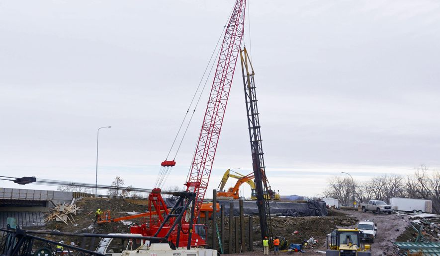 FILE - In this Jan. 15, 2014 file photo, construction crews working on the Russell Street bridge spanning the Big Sioux River channel drive pilings into the ground in Sioux Falls, S.D. On Tuesday, Feb. 3, 2015, a legislative panel has added nearly $2 million in new revenue to Gov. Dennis Daugaard's $50.9 million funding hike for roads and bridges. The House Transportation Committee approved changes to the governor's plan, which raises transportation funding through a variety of increases in fuel taxes, fees and other assessments. (AP Photo/Dirk Lammers, File)
