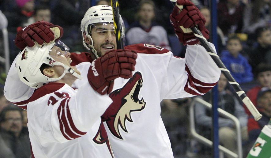 Arizona Coyotes' Brendan Shinnimin, left, and Lucas Lessio celebrate a goal against the Columbus Blue Jackets during the first period of an NHL hockey game Tuesday, Feb. 3, 2015, in Columbus, Ohio. (AP Photo/Jay LaPrete)