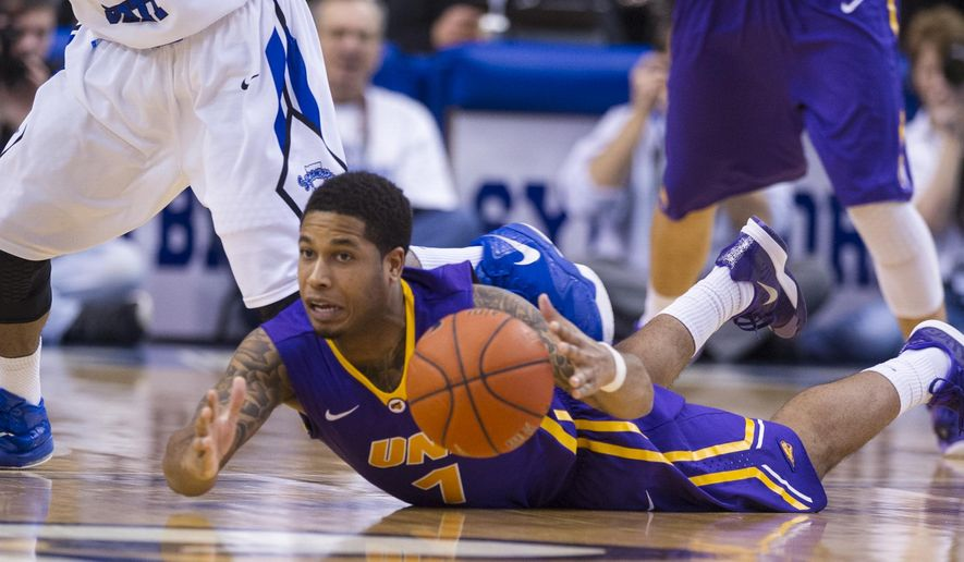 Northern Iowa guard Deon Mitchell (1) dives onto the court to recover a loose ball during the first half of an NCAA college basketball game against Indiana State, Tuesday, Feb. 3, 2015, in Terre Haute, Ind. (AP Photo/Doug McSchooler)