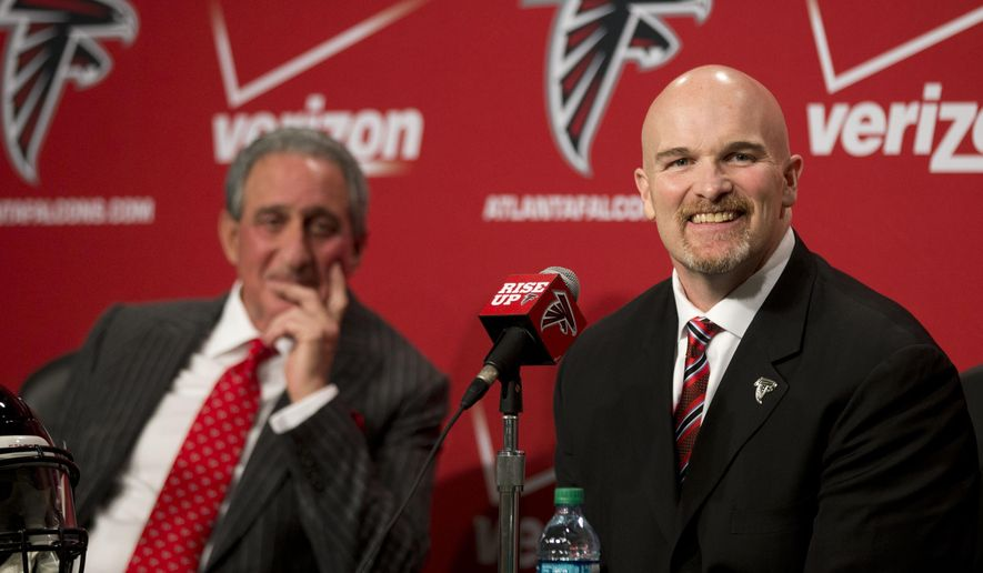 Former Seattle Seahawks defensive coordinator Dan Quinn, right, and Atlanta Falcons owner Arthur Blank laugh as a reporter asks a question during a news conference introducing Quinn as the new head coach of the Atlanta Falcons NFL football team, Tuesday, Feb. 3, 2015, in Flowery Branch, Ga. (AP Photo/John Bazemore) ns  Tuesday, Feb. 3, 2015, Ga. (AP Photo/John Bazemore)