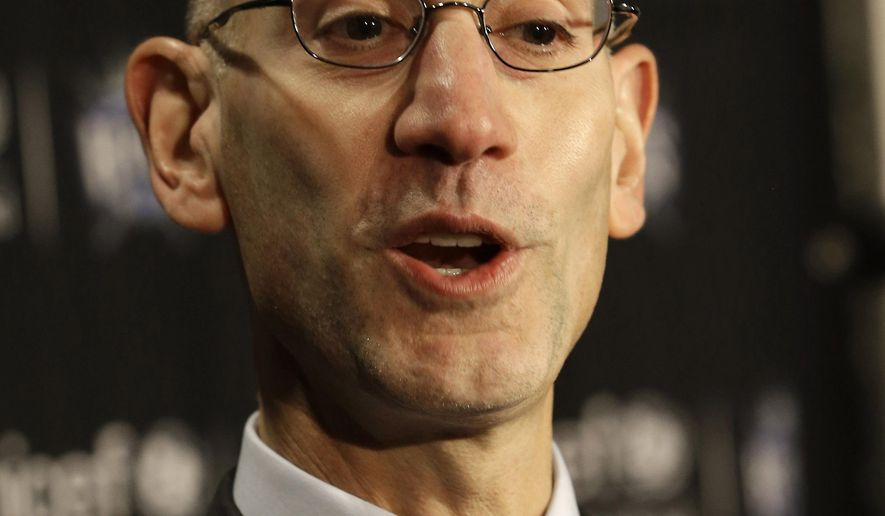 National Basketball Commissioner Adam Silver talks to the media before the Golden State Warriors play the Sacramento Kings in an NBA basketball game  in Sacramento, Calif., Tuesday, Feb. 3, 2015.(AP Photo/Rich Pedroncelli)
