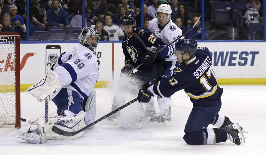 St. Louis Blues' Jaden Schwartz (17) scores the game-winning goal past Tampa Bay Lightning goalie Ben Bishop (30) as Blues' Chris Butler (25) and Lightning's Ondrej Palat, of the Czech Republic, watch during overtime of an NHL hockey game Tuesday, Feb. 3, 2015, in St. Louis. The Blues won 2-1. (AP Photo/Jeff Roberson)