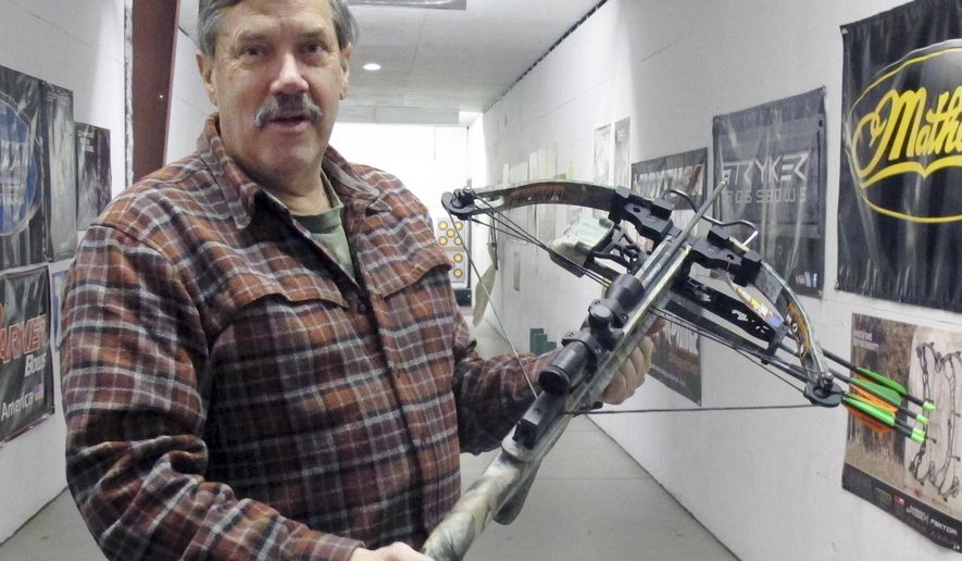 "Rick Sanborn, owner of R&L Archery, holds a crossbow at the archery range in his store Tuesday, Feb. 3, 2015, in Barre, Vt. The Vermont Fish and Wildlife Board is considering changing Vermont's archery deer hunting regulations to expand the use of crossbows. Sanborn said the change, which needs to be approved by the Vermont Legislature, would be ""a huge change."" (AP Photo/Wilson Ring)"