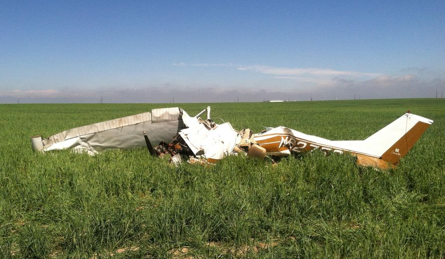 """FILE - In this Saturday, May 31, 2014file photo provided by the Adams County, Colo., Sheriff's Department, the wreckage of small plane in scattered in a field near Watkins, Colo. The National Transportation Safety Board said Tuesday, Feb. 3, 2015, that taking """"selfies"""" was a likely factor in the crash, which killed the pilot and his only passenger when the plane crashed northeast of Denver. (AP Photo/Adams County Sheriff's Department, Sgt. Aaron Pataluna, ,File)"""