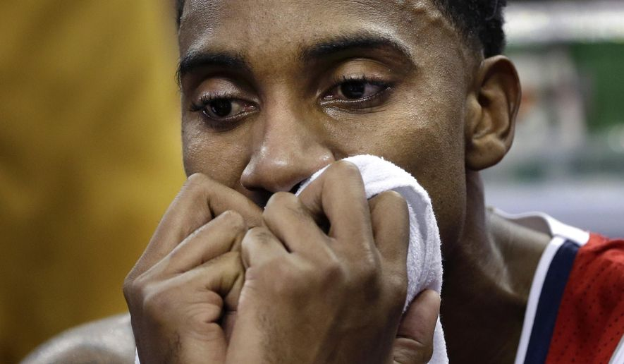 Atlanta Hawks guard Jeff Teague reacts on the bench late in the second half of an NBA basketball game against the New Orleans Pelicans in New Orleans, Monday, Feb. 2, 2015. The Pelicans won 115-100. (AP Photo/Gerald Herbert)
