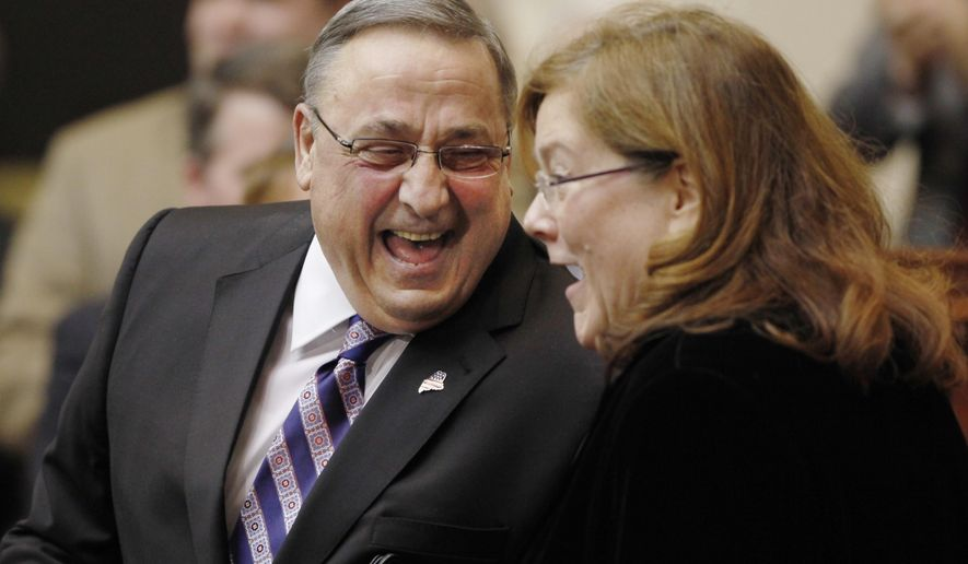 Gov. Paul LePage shares a laugh with Maine Chief Justice leigh Saufley following his State of the State address to the Legislature, Tuesday, Feb. 3, 2015 at the Statehouse in Augusta, Maine. (AP Photo/Joel Page)