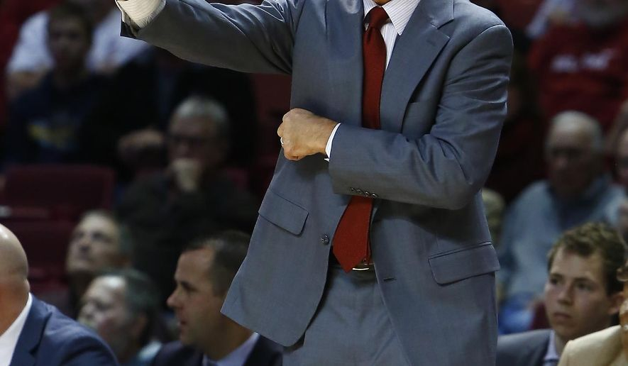 Oklahoma coach Lon Kruger talks to his palyer during the first half of an NCAA college basketball game against West Virginia in Norman, Okla., Tuesday, Feb. 3, 2015. (AP Photo/Alonzo Adams)
