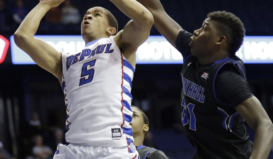 DePaul guard Billy Garrett Jr (5), shoots against Seton Hall forward Angel Delgado (31) during the second half of an NCAA college basketball game in Rosemont, Ill., Tuesday, Feb. 3, 2015. DePaul won 75-62. (AP Photo/Nam Y. Huh)