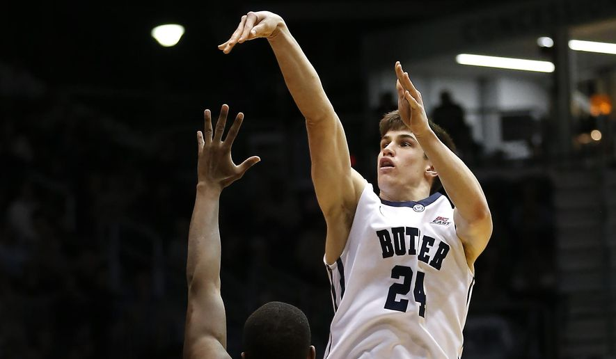 Butler guard Kellen Dunham (24) hits this shot over St. John's guard Phil Greene IV (1) during the second half of an NCAA college basketball game in Indianapolis Tuesday, Feb. 3, 2015. Butler won the game 85-62. (AP Photo/Sam Riche)