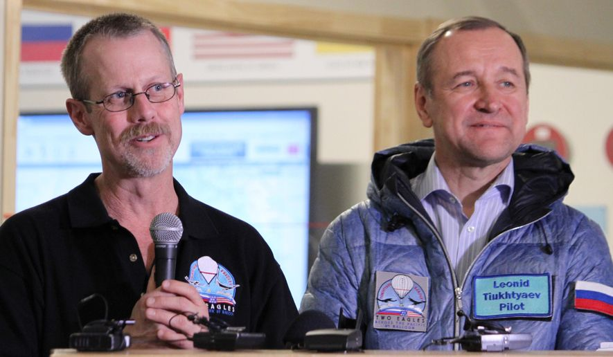Pilots Troy Bradley, left, and Leonid Tiukhtyaev discuss their flight across the Pacific Ocean during a final debriefing at mission control in Albuquerque, N.M. on Monday, Feb. 2, 2015. The pilots surpassed distance and duration records. (AP Photo/Susan Montoya Bryan)