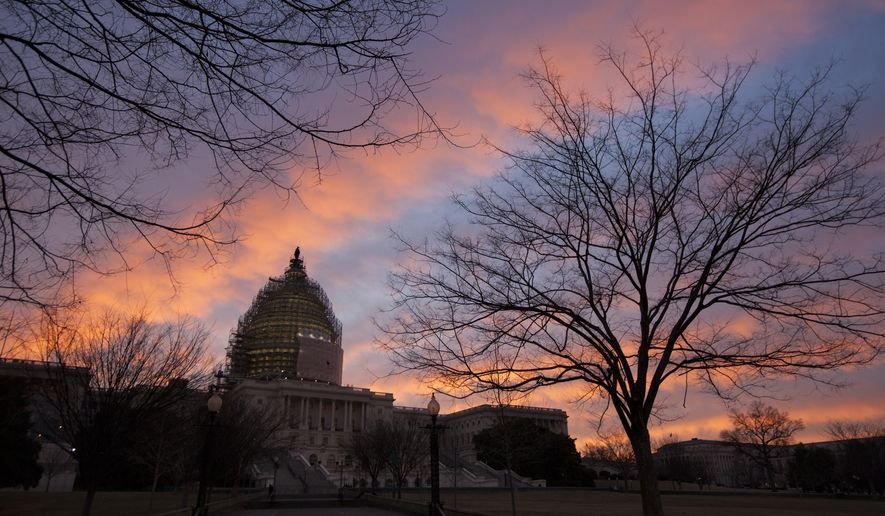 A palette of pinks and blues paint the morning sky behind the U.S. Capitol in Washington, Tuesday, Feb. 3, 2015.    (AP Photo/J. Scott Applewhite)
