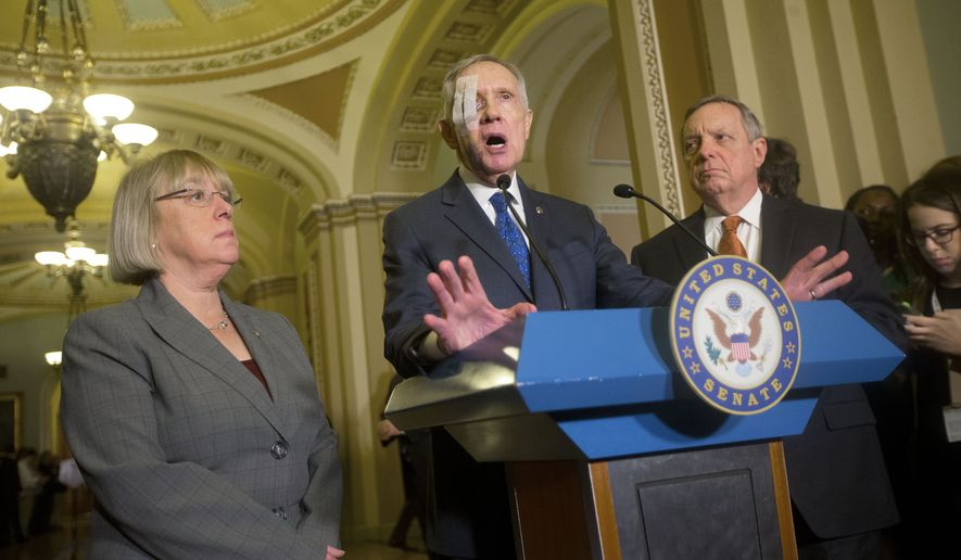 Democratic Minority Leader Harry Reid, D-Nev., center, with Sen. Patty Murray, D-Wash., left, and Sen. Dick Durbin, D-Ill., right, answers questions from reporters following their weekly policy luncheon, at the Capital in Washington, Tuesday, Feb. 3, 2015. (AP Photo/Pablo Martinez Monsivais)