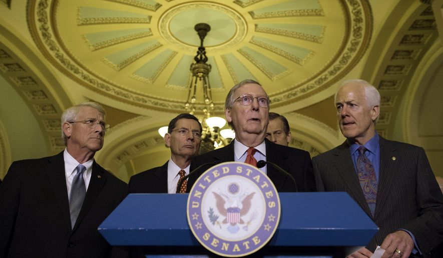 Senate Majority Leader Mitch McConnell, R-Ky. addresses the media with from left, Sen. Roger Wicker, R-Miss., Sen. John Barrasso, R-Wyo., Sen. John Thune, R-S.D., and Senate Majority Whip John Cornyn of Texas in the U.S. Capitol in Washington, Tuesday, February 3, 2015.   Republicans newly in charge of Congress challenged President Barack Obama at both ends of the Capitol on Tuesday, lining up in the House to repeal the health care program he signed into law and struggling in the Senate to roll back the immigration policies he issued on his own.  (AP Photo/Molly Riley)