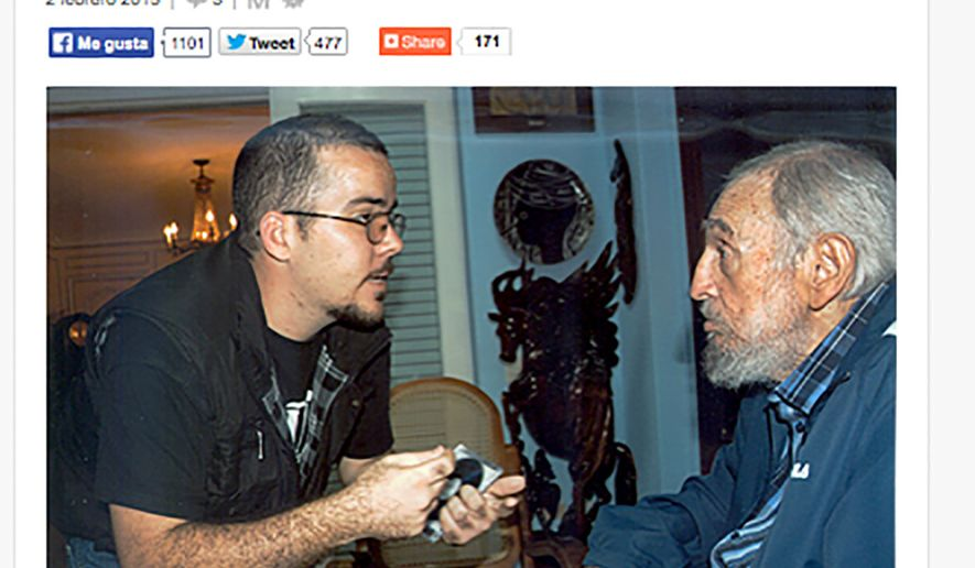 A screenshot of Cuba's website Cubadebate shows a photo of Fidel Castro with the head of the main Cuban student union Randy Perdomo Garcia  in Havana, Cuba, Tuesday Feb. 3, 2015. Cuba has published the first photos of Fidel Castro in five months, showing the 88-year-old former leader engaged in conversation with Perdomo Garcia. A first-person account by the student leader  says the meeting took place on Jan. 23. (AP Photo)