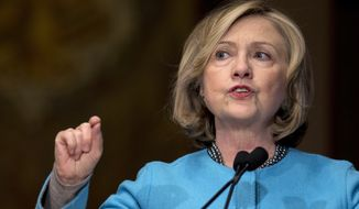 Former Secretary of State Hillary Rodham Clinton speaks at Georgetown University in Washington in this Dec. 3, 2014, file photo. (AP Photo/Carolyn Kaster, File)