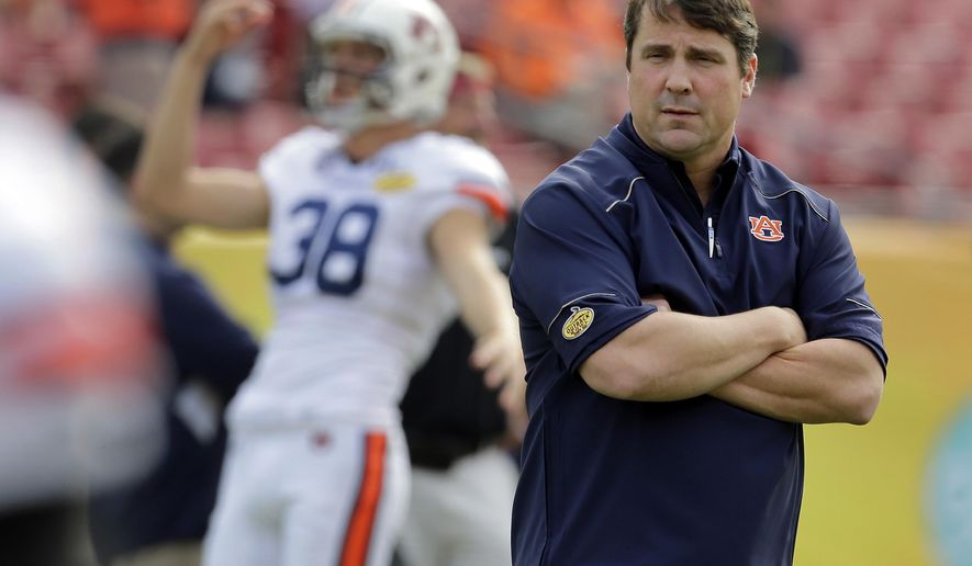FILE  - Int his Jan. 1, 2015, file photo, Auburn defensive coordinator Will Muschamp watches before the Outback Bowl NCAA college football game in Tampa, Fla. . The former Gators coach, who was fired last season and hired as Auburn's defensive coordinator two weeks after he coached his final game for Florida, has the Tigers in position to make a signing day surge. (AP Photo/Chris O'Meara, File)