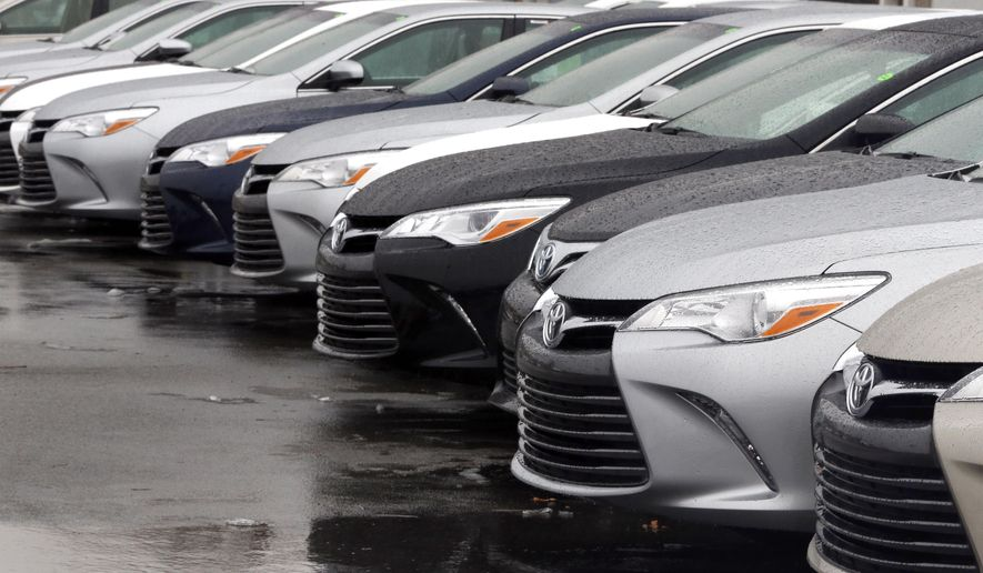 In this Monday, Jan. 12, 2015 photo, Toyota cars for sale are parked at a dealership in Danvers, Mass. Automakers report sales for the month of January, on Tuesday, Feb. 3, 2015. (AP Photo/Elise Amendola)