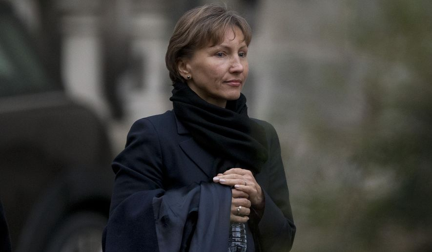 Marina Litvinenko, the widow of former Russian intelligence officer Alexander Litvinenko, leaves after testifying at the inquiry into her husband's death at the Royal Courts of Justice in London, Monday, Feb. 2, 2015.  The widow of former KGB officer Alexander Litvinenko described him Monday as a loyal intelligence agent who grew disillusioned with Russia's 1990s war in Chechnya and what he saw as the country's corrupted security services.  (AP Photo/Matt Dunham)