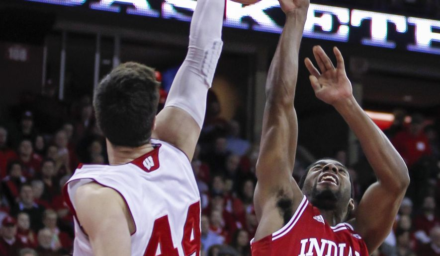 Wisconsin's Frank Kaminsky (44) bats away a shoot by Indiana's Robert Johnson during the first half of an NCAA college basketball game Tuesday, Feb. 3, 2015, in Madison, Wis. (AP Photo/Andy Manis)