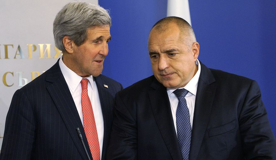 In this Jan. 15, 2015 file photo, U.S. Secretary of State, John Kerry, left, talks with Bulgarian Prime Minister, Boyko Borisov, before holding a joint news conference in Sofia, Bulgaria Thursday, Jan. 15, 2015.  Kerry visited Bulgaria to push for a new gas spur and press an American company's bid to build a new nuclear plant there. Bulgaria relies on Russia for 85 percent of its gas and all of its nuclear power. Its prices, among NATO's highest, are a concern within the alliance, which prides itself on winning the Cold War.  (AP Photo/Rick Wilking, Pool)