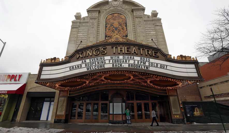 """The marquee of the Kings Theater heralds its opening night headliner, Diana Ross, in the Brooklyn borough of New York, Monday, Feb. 2, 2015.  The theater that was one of the """"four wonders"""" of America's newly hatched movie culture is back decades after it was shuttered, a crumbling relic of a glorious era.  (AP Photo/Richard Drew)"""