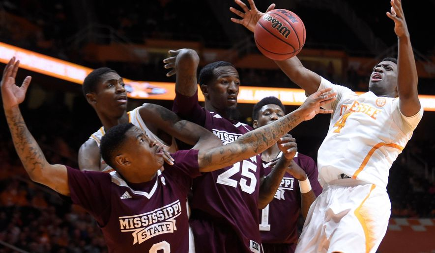 Mississippi State guard Trivante Bloodman (3) and forward Roquez Johnson (25), and Tennessee guard Armani Moore (4) compete for a rebound during the first half of an NCAA college basketball game at Thompson-Boling Arena in Knoxville, Tenn., on Tuesday, Feb. 3, 2015. (AP Photo/Knoxville News Sentinel, Adam Lau)