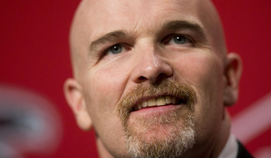 Former Seattle Seahawks defensive coordinator Dan Quinn listens to a question during a news conference introducing him as the new head coach of the Atlanta Falcons NFL football team, Tuesday, Feb. 3, 2015, in Flowery Branch, Ga. (AP Photo/John Bazemore)