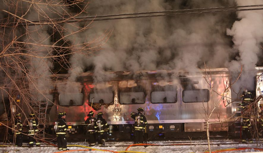 A Metro-North Railroad passenger train smolders after hitting a vehicle in Valhalla, N.Y., Tuesday, Feb. 3, 2015. (AP Photo/The Journal News, Frank Becerra Jr) NYC METRO OUT, TV OUT, MAGS OUT, NO SALES
