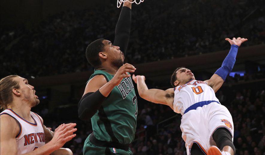 Boston Celtics forward Jared Sullinger (7) fouls New York Knicks guard Shane Larkin (0) during the first half of NBA basketball game, Tuesday, Feb. 3, 2015 at Madison Square Garden in New York.  (AP Photo/Mary Altaffer)