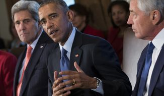 Secretary of State John Kerry, left, and Secretary of Defense Chuck Hagel, right, look on as President Barack Obama delivers remarks on his budget proposal during a cabinet meeting in the Cabinet Room of the White House, on Tuesday, Feb. 3, 2015, in Washington. (AP Photo/Evan Vucci)