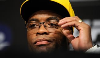 Anderson Silva looks on during the post fight news conference after his loss to Chris Weidman at a UFC 162 mixed martial arts middleweight championship bout Saturday, July 6, 2013, in Las Vegas. Weidman won with a second round TKO. (AP Photo/David Becker)