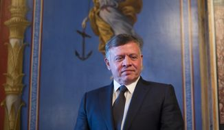 King Abdullah II of Jordan is seen waiting before his meeting with Senate Appropriations members in the Capitol Building in Washington, Tuesday, Feb. 3, 2015. King Abdullah had no comment to a video released online today purportedly showing a Jordanian pilot captured by the Islamic State extremist group in Syria being burned to death by his captors following a weeklong drama over possible prisoner exchange. (AP Photo/Pablo Martinez Monsivais)