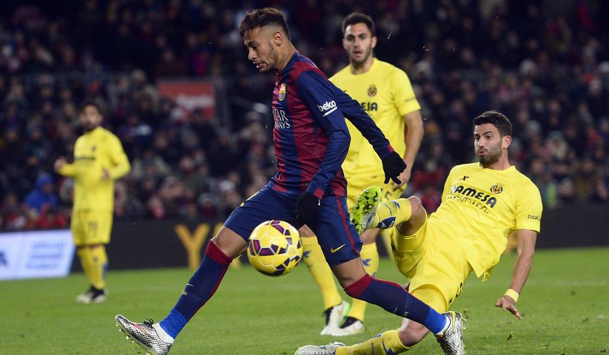 FC Barcelona's Neymar, from Brazil, left, in action against Villarreal's Mateo Musacchio, right, during a Spanish La Liga soccer match at the Camp Nou stadium in Barcelona, Spain, Sunday, Feb. 1, 2015. (AP Photo/Manu Fernandez)