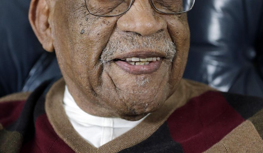 FILE - In this Nov. 13, 2014,  file photo former PGA golfer Charlie Sifford talks during an interview at his home in Brecksville, Ohio. Sifford, who fought the Caucasian-only clause on the PGA Tour and became its first black member has died Monday night Feb. 2, 2015. He was 92. The PGA of America confirmed the death of Sifford, who recently suffered a stroke. No cause of death was given. (AP Photo/Mark Duncan)