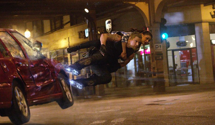 """This photo provided by courtesy of Warner Bros. Pictures shows, Channing Tatum as Caine Wise and Mila Kunis as Jupiter Jones in Warner Bros. Pictures' and Village Roadshow Pictures' """"Jupiter Ascending,"""" an original science fiction epic adventure from Lana and Andy Wachowski. The movie is a Warner Bros. Pictures release. (AP Photo/Warner Bros. Pictures)"""