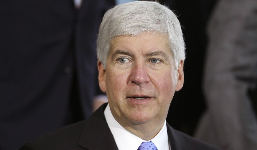 FILE - This June 20, 2014 file photo shows Michigan Gov. Rick Snyder during a ceremony in Detroit. Michigan will recognize more than 300 same-sex marriages performed during a brief window when they were allowed last year, Gov. Snyder announced Wednesday, Feb. 4, 2015. The Republican governor said he will not appeal a federal ruling last month that the state must recognize the marriages. U.S. District Judge Mark Goldsmith said the marriages are valid but put on hold his decision for 21 days pending any appeal by the state. (AP Photo/Carlos Osorio, file)