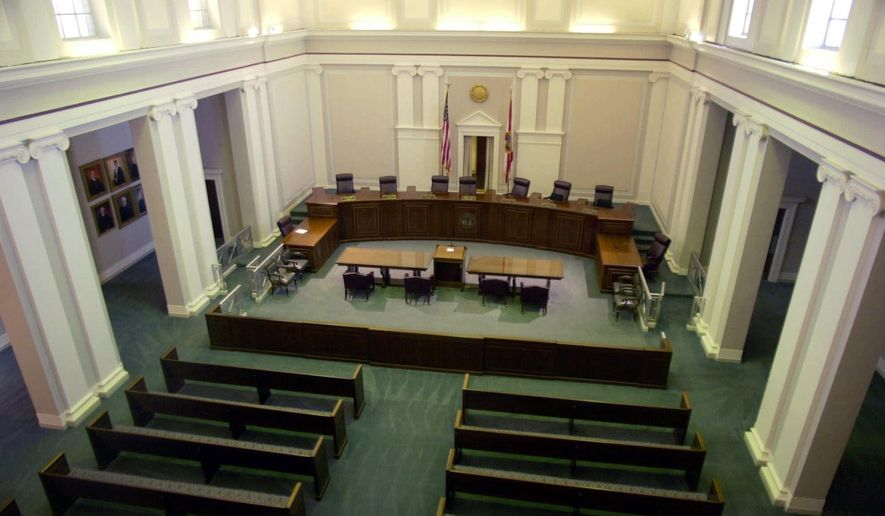 """In this Wednesday, Nov. 15, 2000 file photo, the interior view of the Florida State Supreme Court chamber pictured, in Tallahassee, Fla.The state's Supreme Court justices are pondering the question in a case that threatens to weaken a 1986 law requiring HIV-positive people to reveal their infection before having """"sexual intercourse."""" (AP Photo/Mark Foley, File)"""
