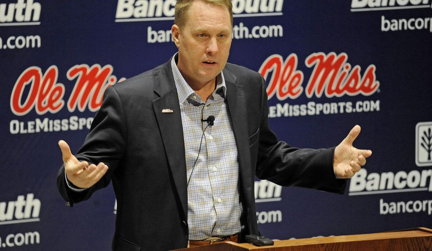 Mississippi head coach Hugh Freeze speaks at a news conference in Oxford, Miss., Wednesday, Feb. 4, 2015, as he unveils his NCAA college football recruiting class on national signing day. (AP Photo/The Daily Mississippian, Thomas Graning)