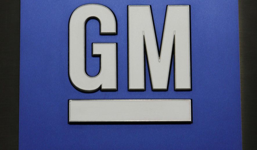 FILE - This Jan. 25, 2010, file photo, shows a General Motors Co. logo during a news conference in Detroit. General Motors Co. reports quarterly financial results, Wednesday, Feb. 4, 2015. (AP Photo/Paul Sancya, File)